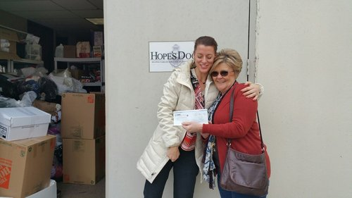 SWC Group employee, Melody Sasser, presenting check for $645 to Hope's Door
